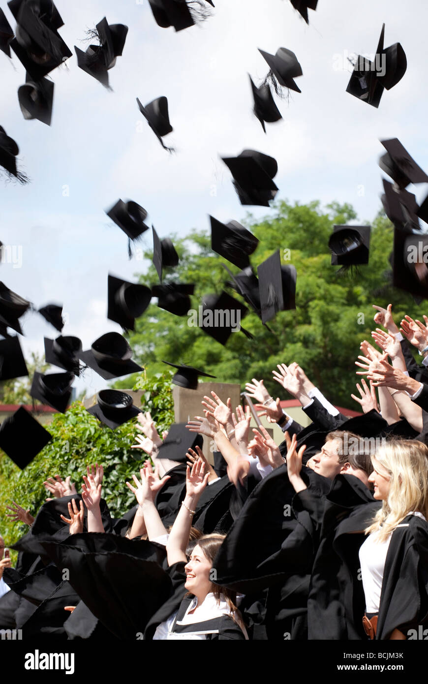 students throw there mortar boards high in to the air after stock stock photo students throw there mortar boards high in to the air after graduating at university of birmingham england uk