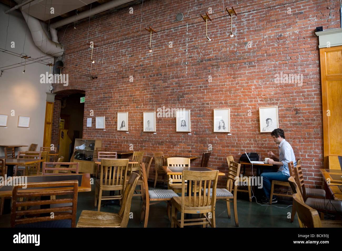 Man With Laptop At Zeitgeist Coffee Shop Interior In