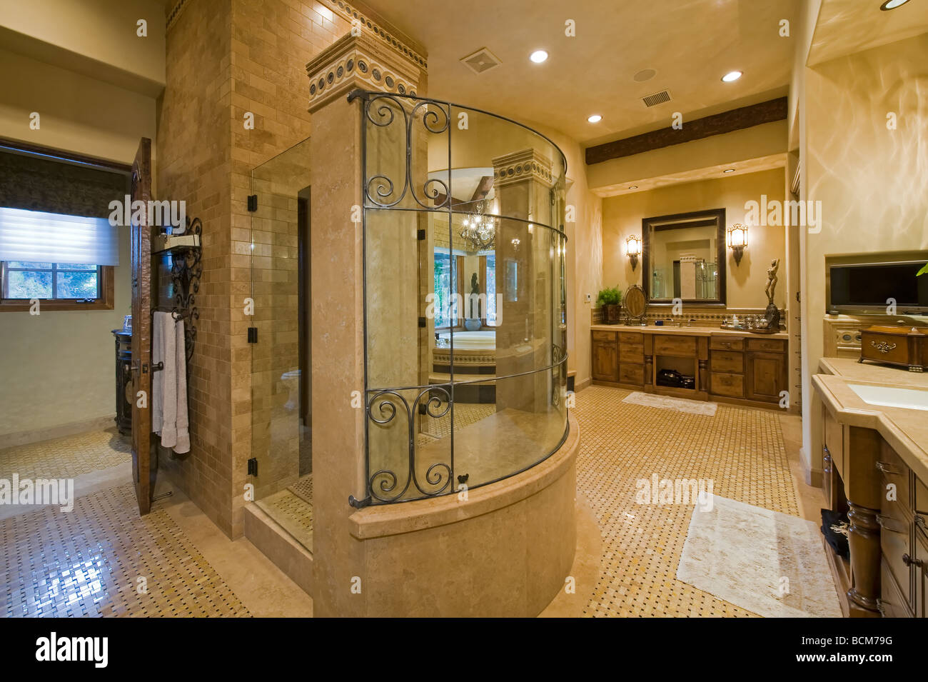 large luxury bath with glass walk in shower