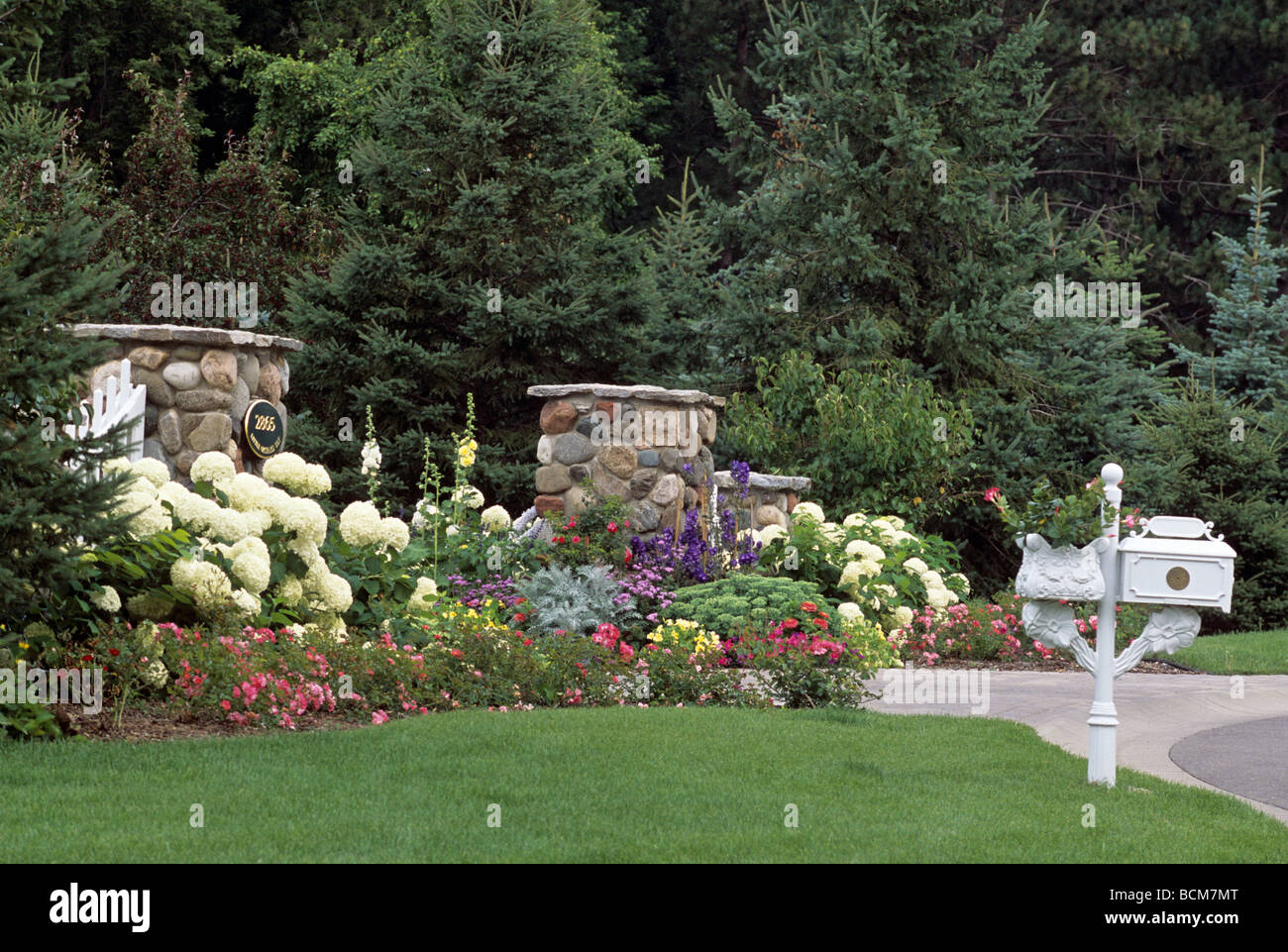 FRONT ENTRANCE GATE POSTS AND MAILBOX OF SUBURBAN MINNEAPOLIS, MINNESOTA  HOME WITH BORDER GARDEN OF PERENNIALS. SUMMER