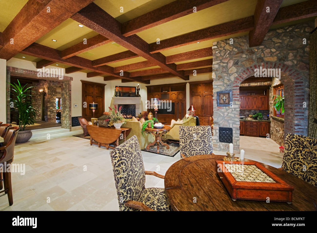 Mediterranean Decor Family Room With Beamed Ceiling And Beautiful Built In  Cabinets And Rich Furnishings