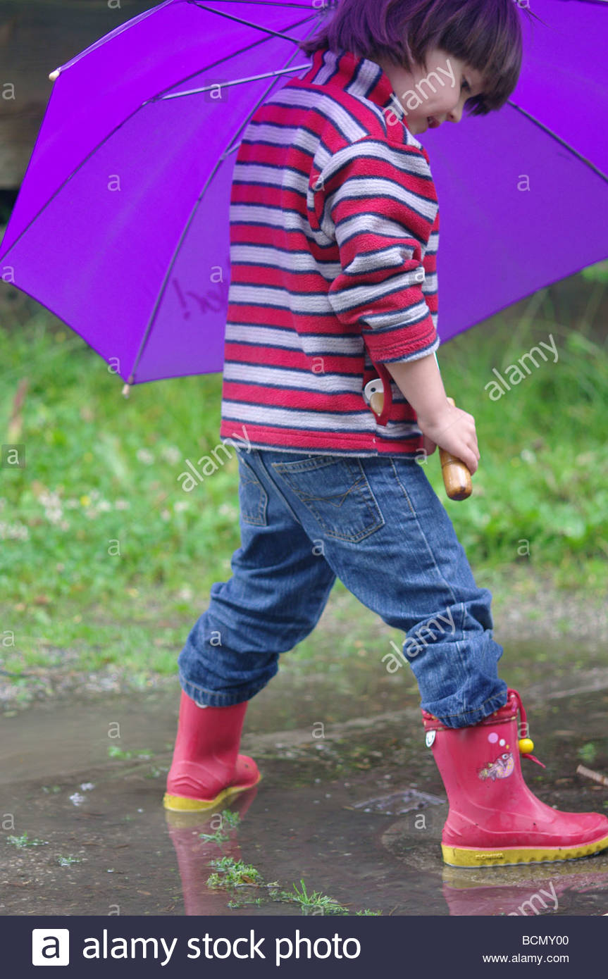 two children are playing with rain water stock photo royalty free