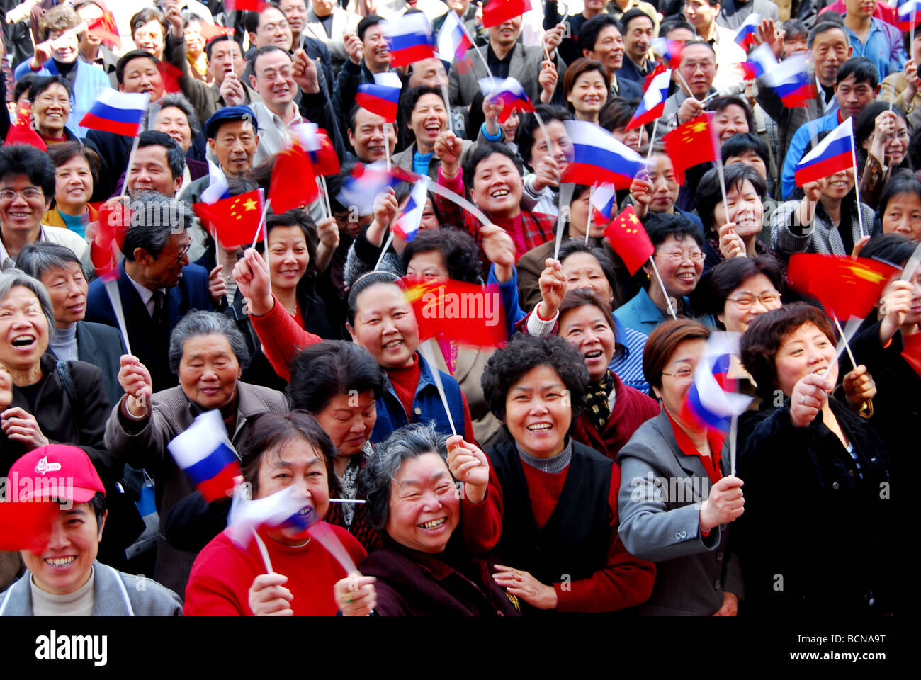 chinese people waving flags of russia and china shanghai china