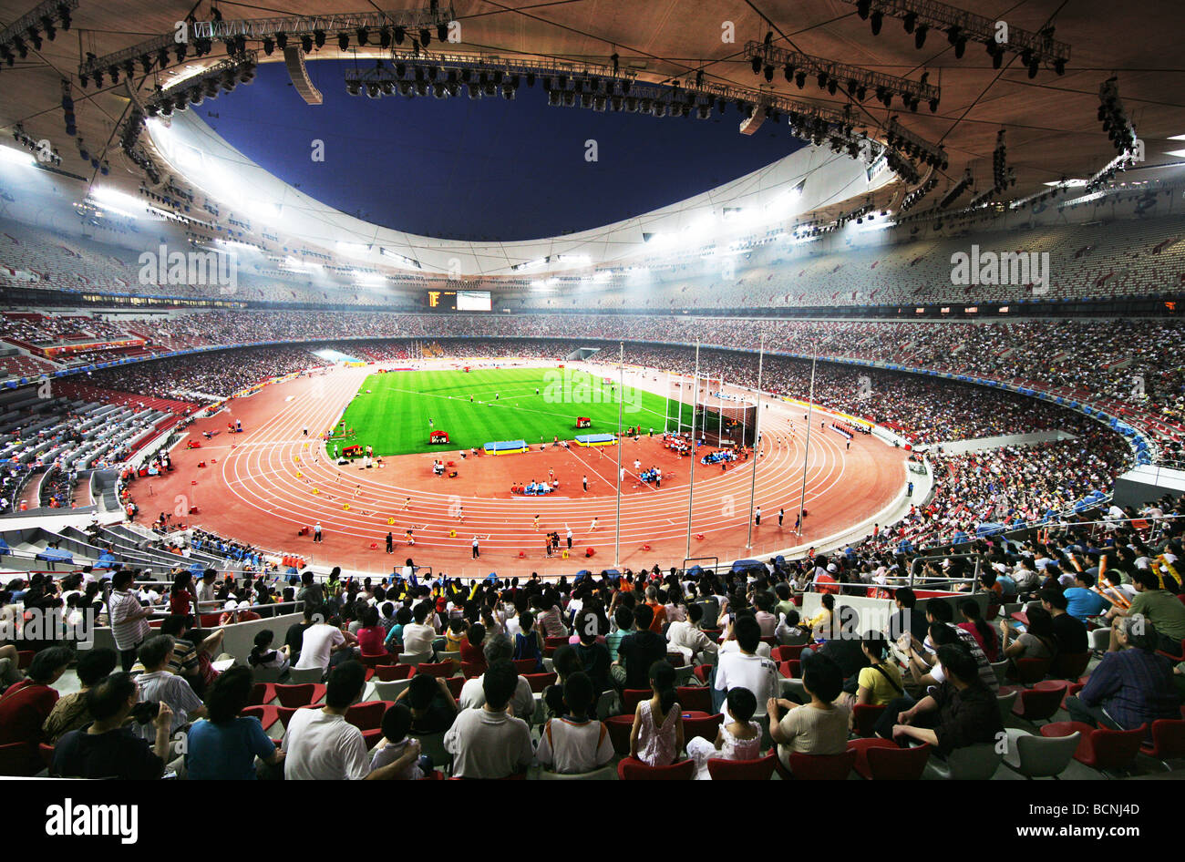 Spectators enjoy games of track and field inside the bird for The nest beijing