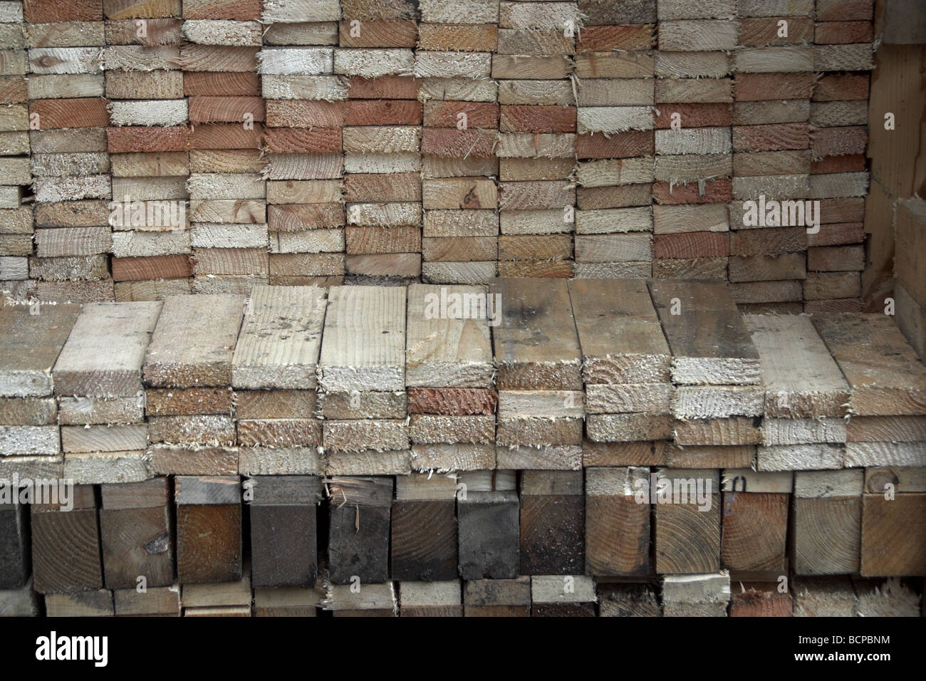 dismantled pallets cut up and stored for use in a wood burning