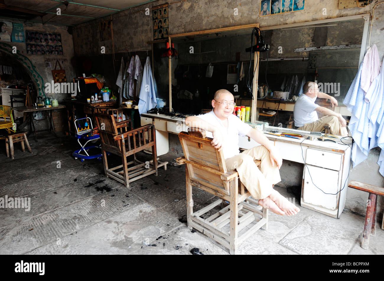 Old barber shop chairs - Old Barber Sitting In The Barber Chair Fuxin Hair Barber Shop Lizhuang Ancient Town