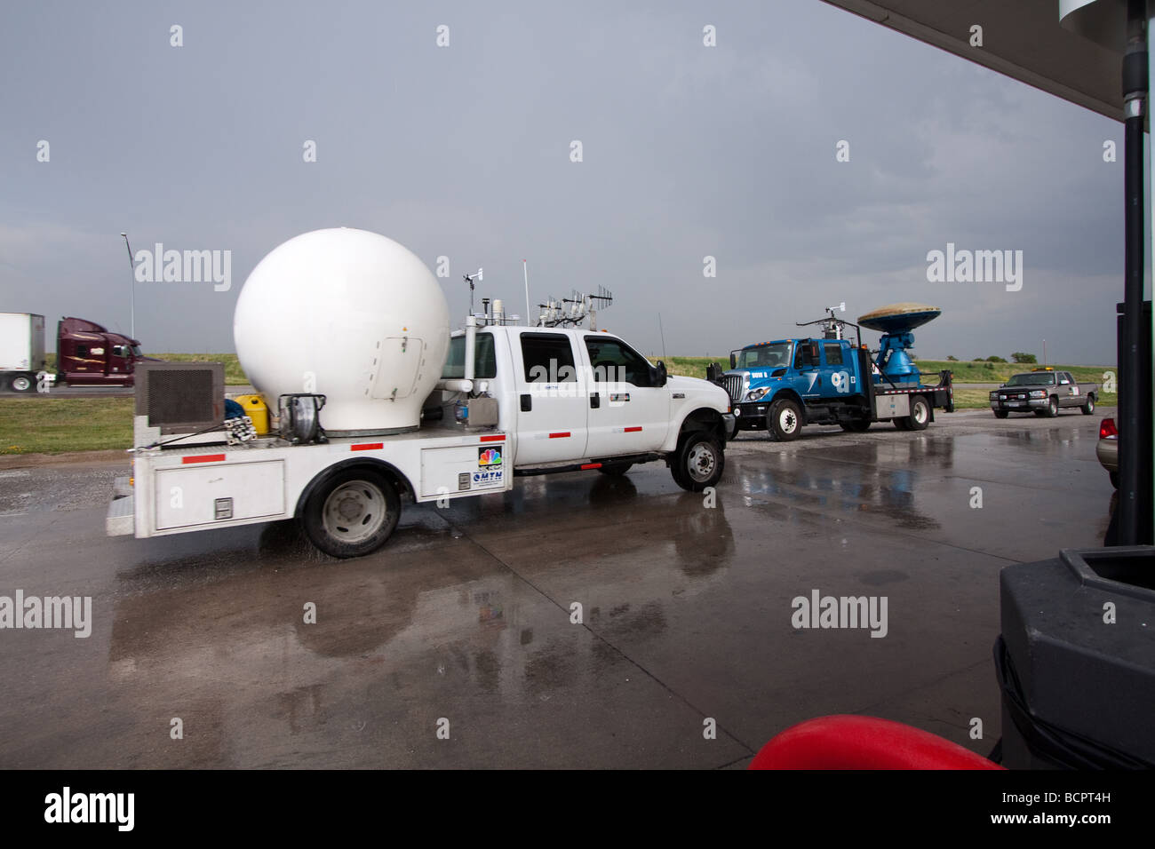 mobile doppler radar research vehicles parked in a gas station stock photo royalty free image. Black Bedroom Furniture Sets. Home Design Ideas