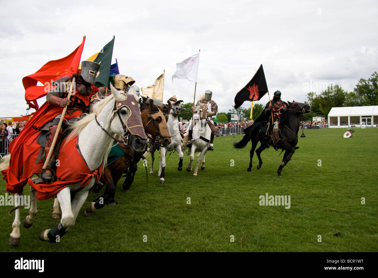 http://c8.alamy.com/comp/BCR1WT/medieval-knights-on-galloping-horses-carrying-standards-or-flags-lambeth-BCR1WT.jpg