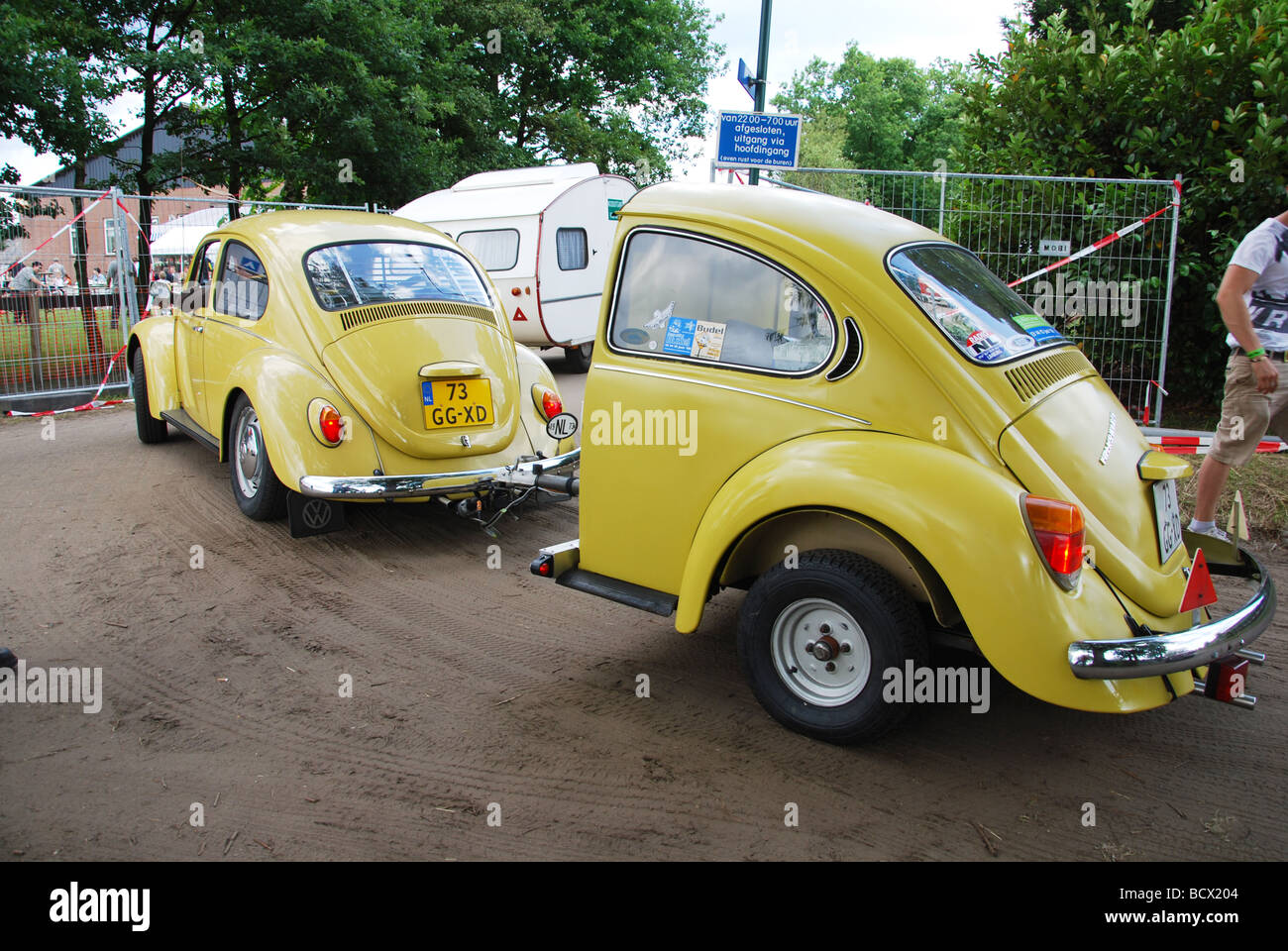 classic vw beetle with identical trailer stock photo