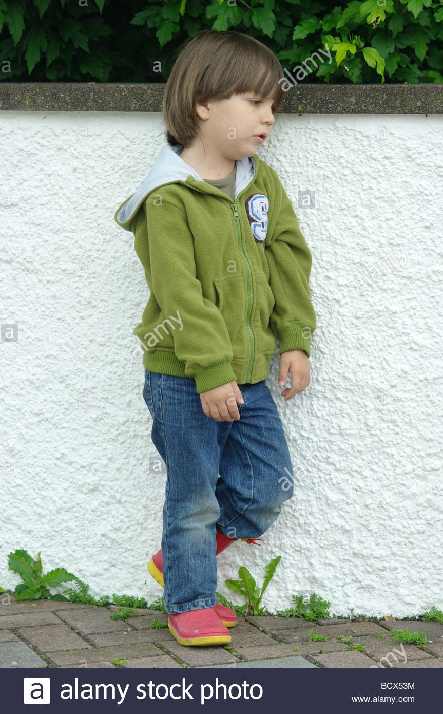 child little boy standing garden full length sad stock