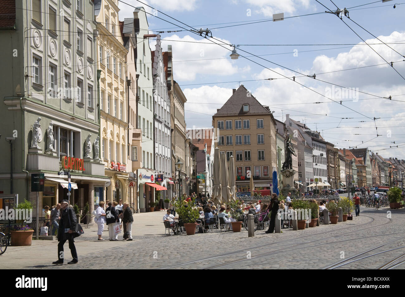 augsburg bavaria germany eu a busy open air cafe in a square on stock photo royalty free image. Black Bedroom Furniture Sets. Home Design Ideas