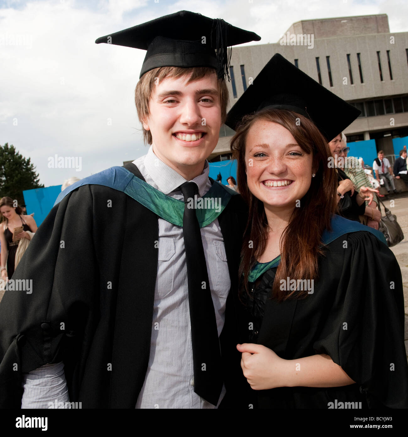 Ex Students Wearing Gown And Mortar Board On Graduation Day Stock ...