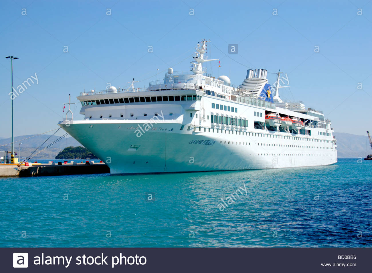 GRAND VOYAGER CRUISE SHIP IN CORFU GREECE Stock Photo Royalty - Grand voyager cruise ship