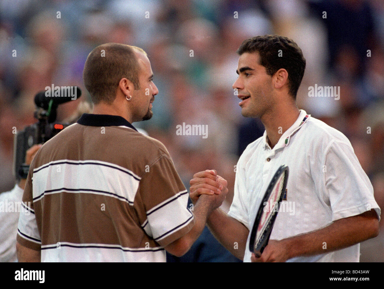 Pete Sampras USA congratulated by Andre Agassi USA on his victory