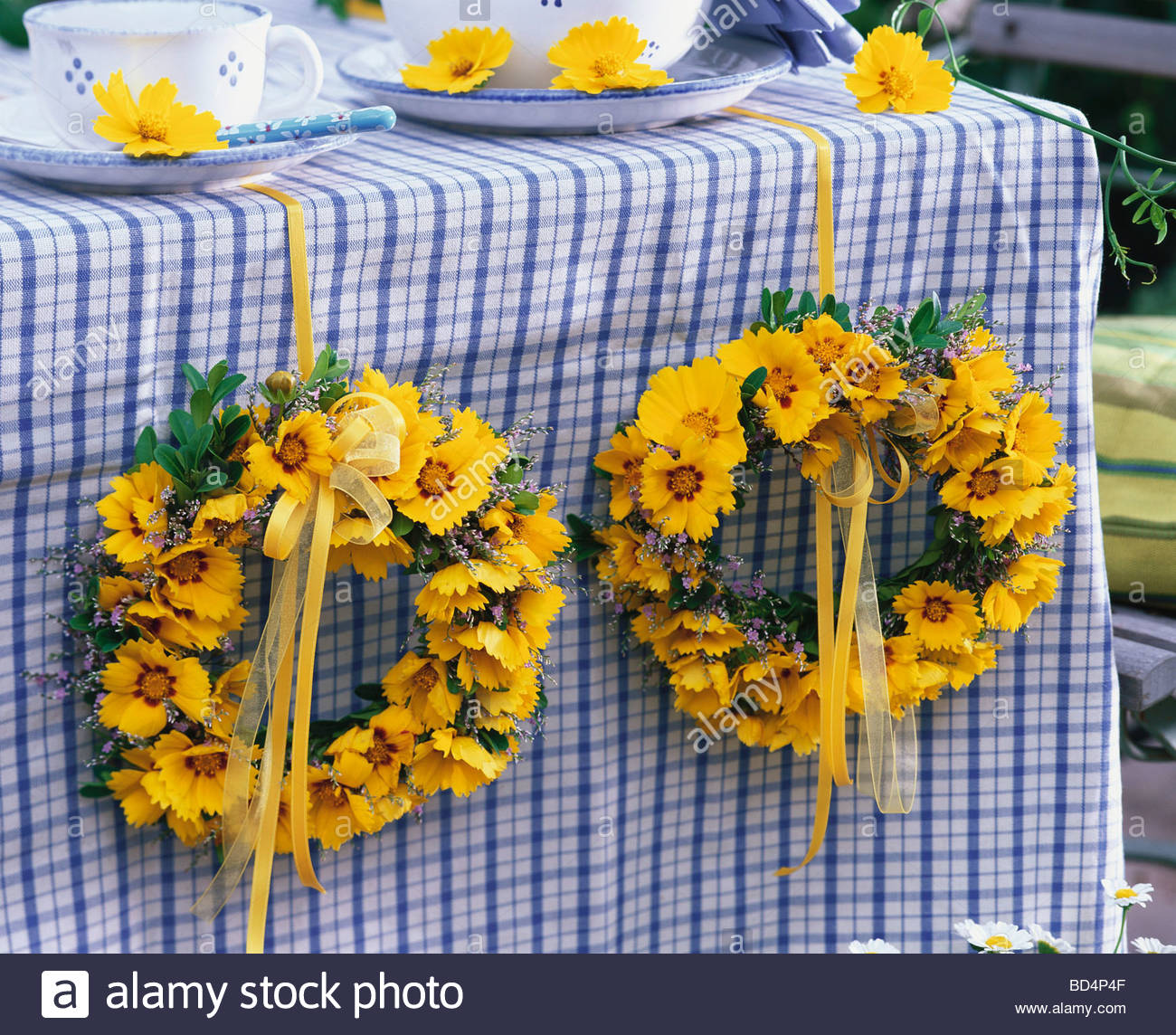 Of Wreaths Table Decoration Of Wreaths Of Coreopsis And Sea Lavender Stock