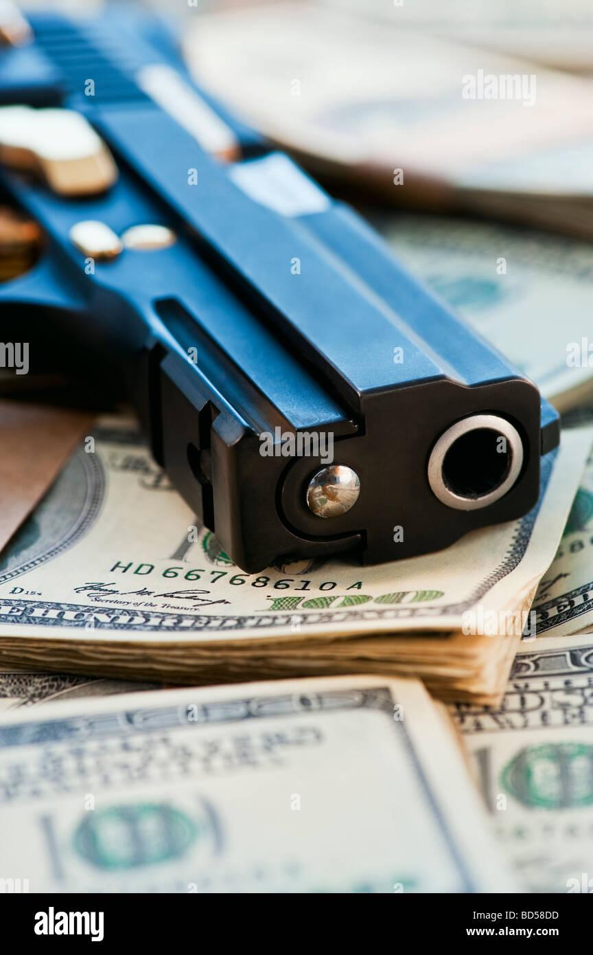 A Handgun On Stacks Of Money Stock Photo, Royalty Free ...