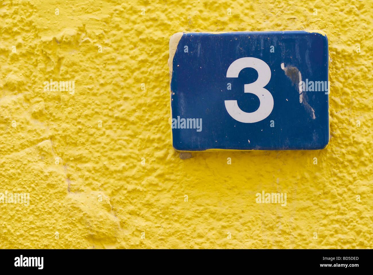 Blue ceramic tile indicating street number 3 on the yellow wall of blue ceramic tile indicating street number 3 on the yellow wall of a building in deira dubai united arab emirates uae dailygadgetfo Image collections