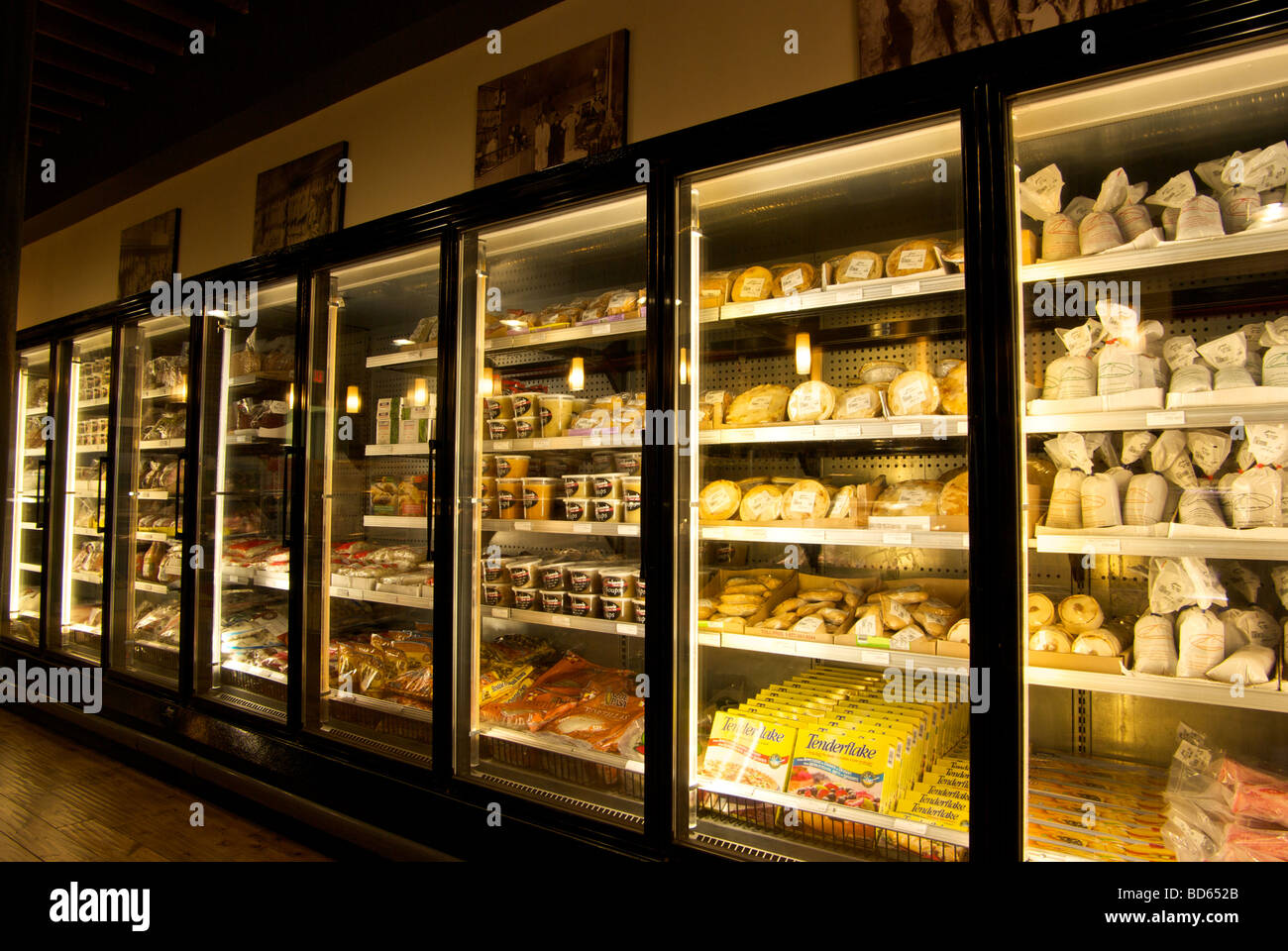 stock photo upright freezer display case in small retail grocery store - Small Upright Freezer