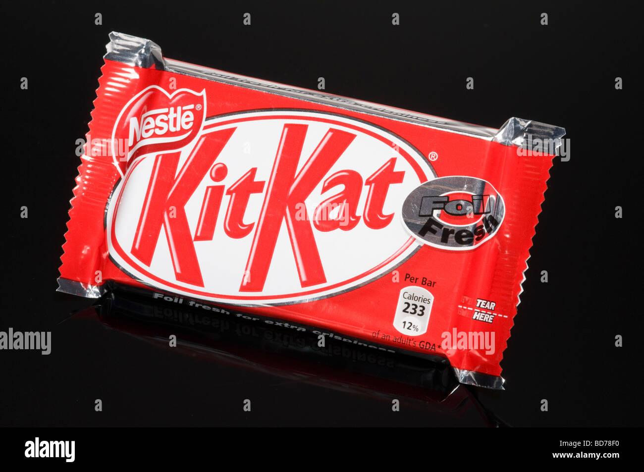 Nestle kitkat chocolate bar on black background shot in studio nestle kitkat chocolate bar on black background shot in studio voltagebd Images