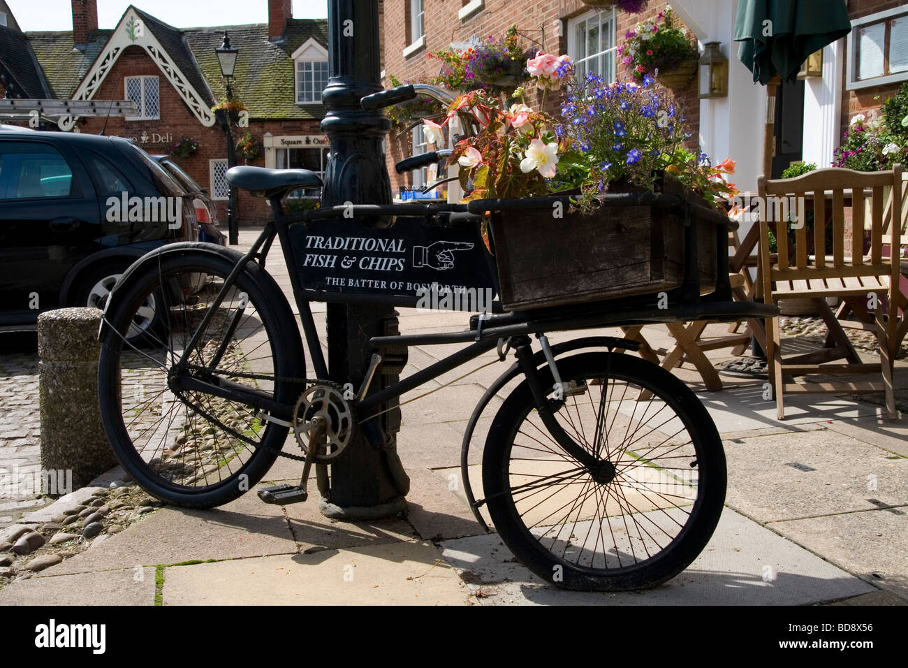 Freshwater fish and chip shop - A Fish And Chip Shop Sign On A Bike In Market Bosworth Stock Image