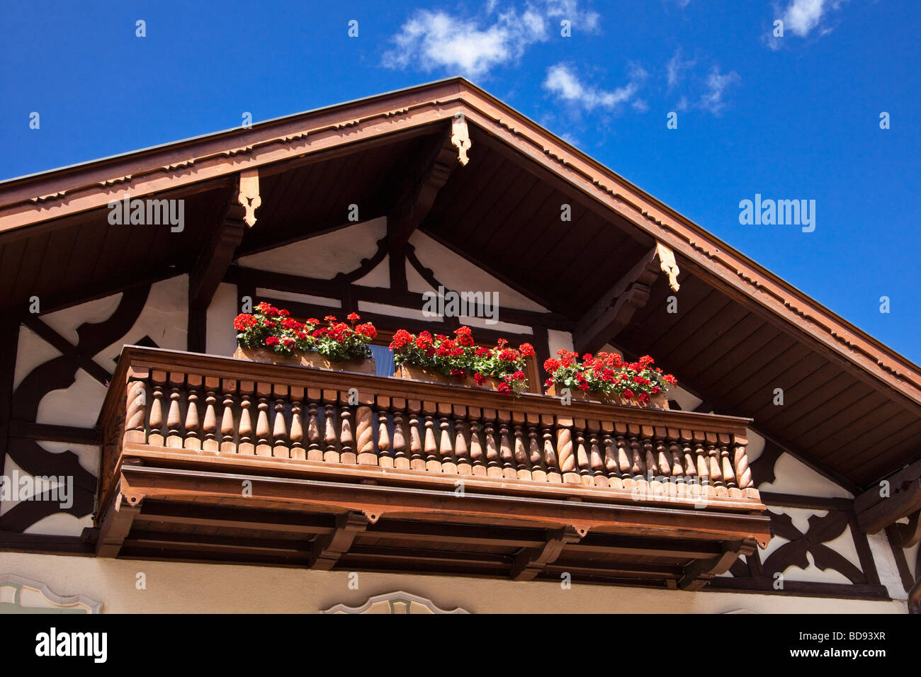 Traditional german balcony with flowers in window boxes on for Traditional balconies