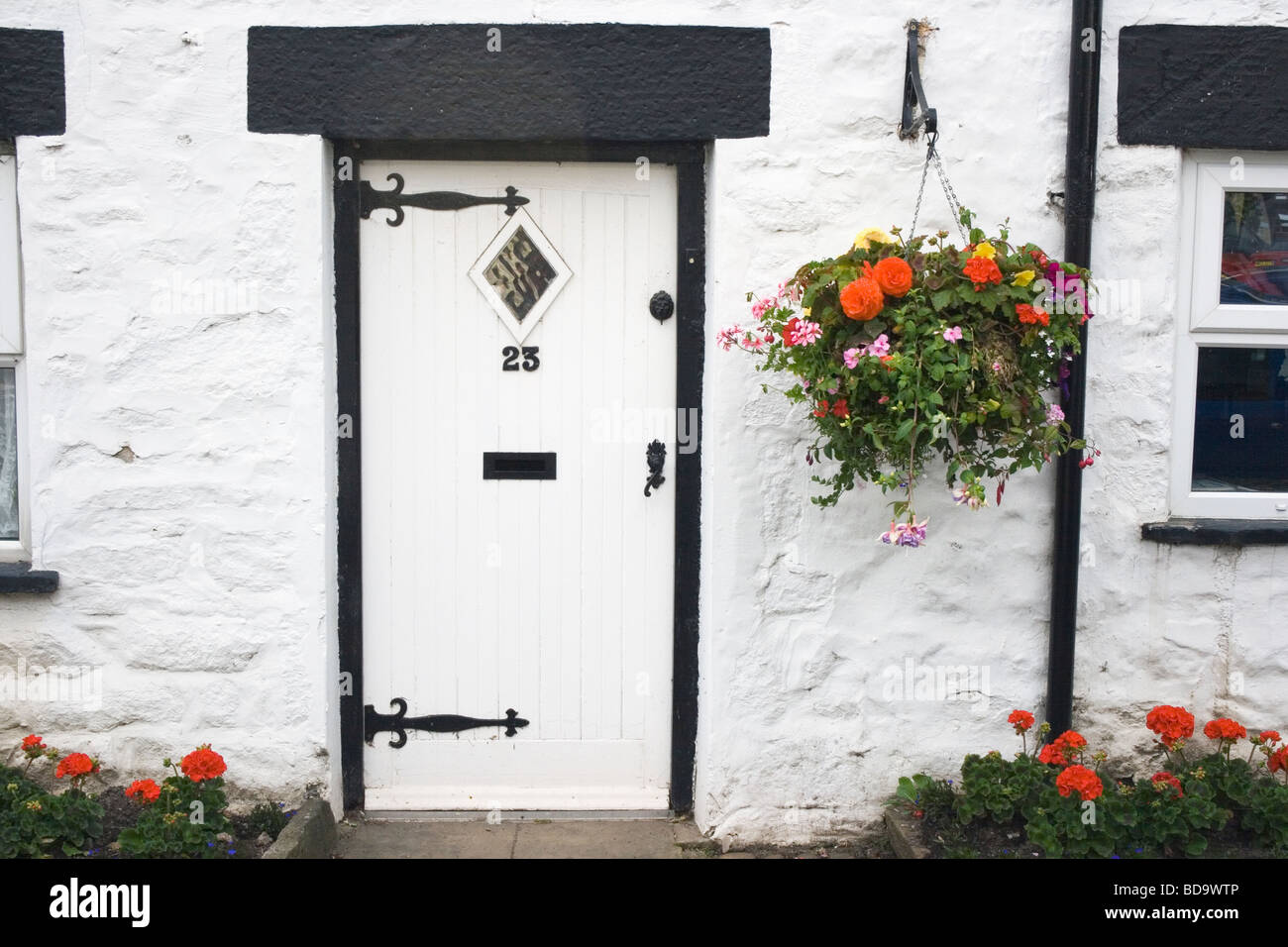 Front Door And Hanging Basket Outside Typical English Country Cottage