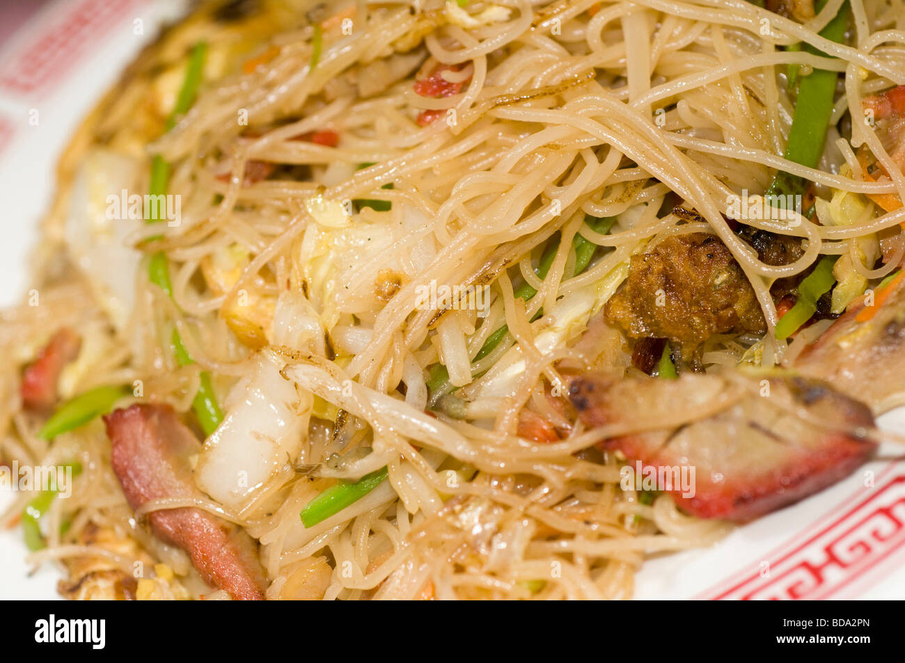 Stock Photo Thin Flat Rice Noodles With Roast Pork Slices And Vegetables At Chinese Restaurant