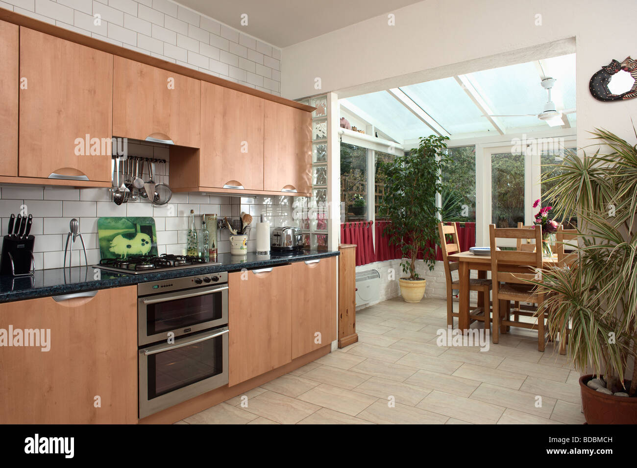 Fitted wood units in modern kitchen with beige ceramic for Wooden fitted kitchen