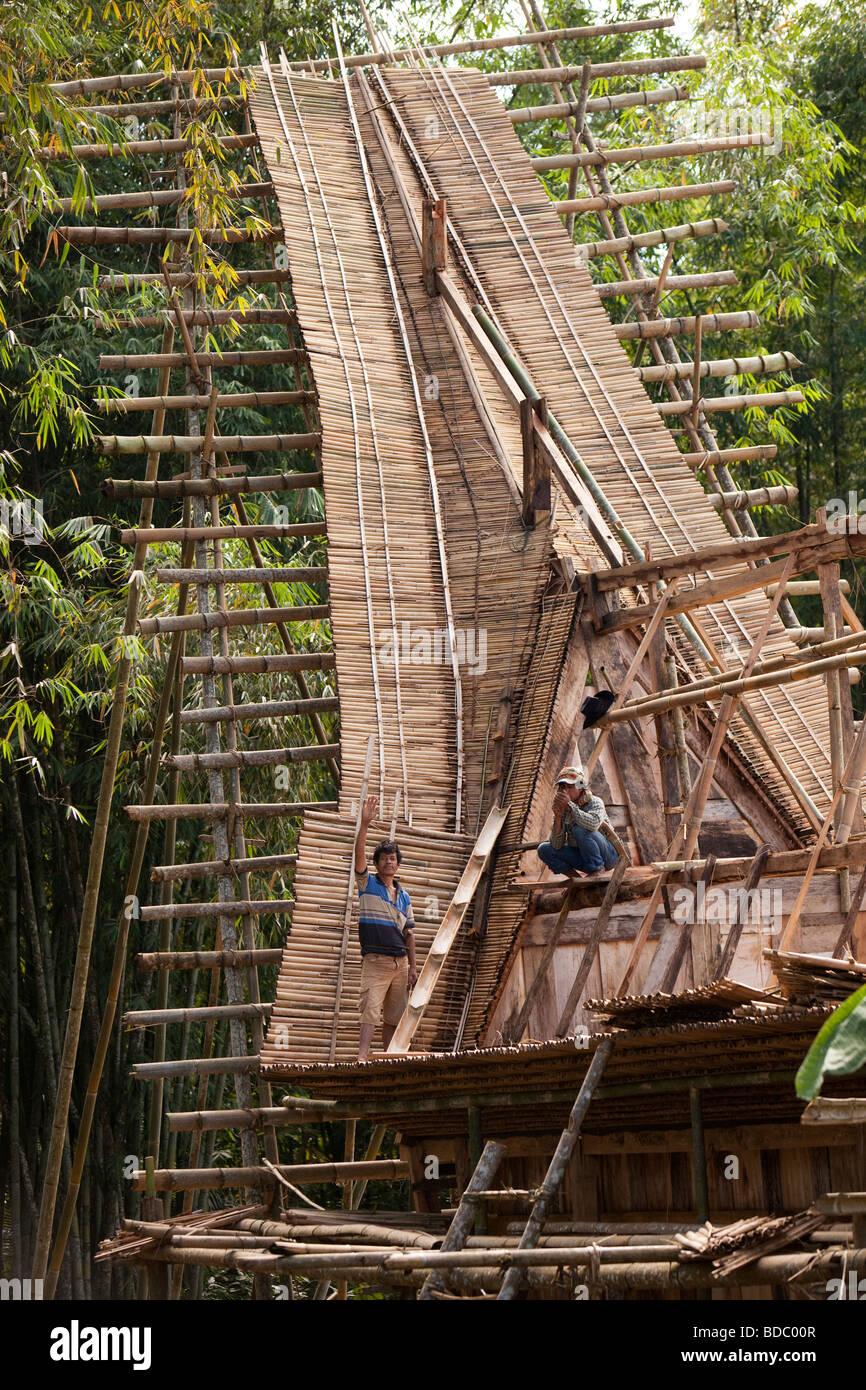 Traditional Construction indonesia sulawesi tana toraja bebo tongkonan house being built