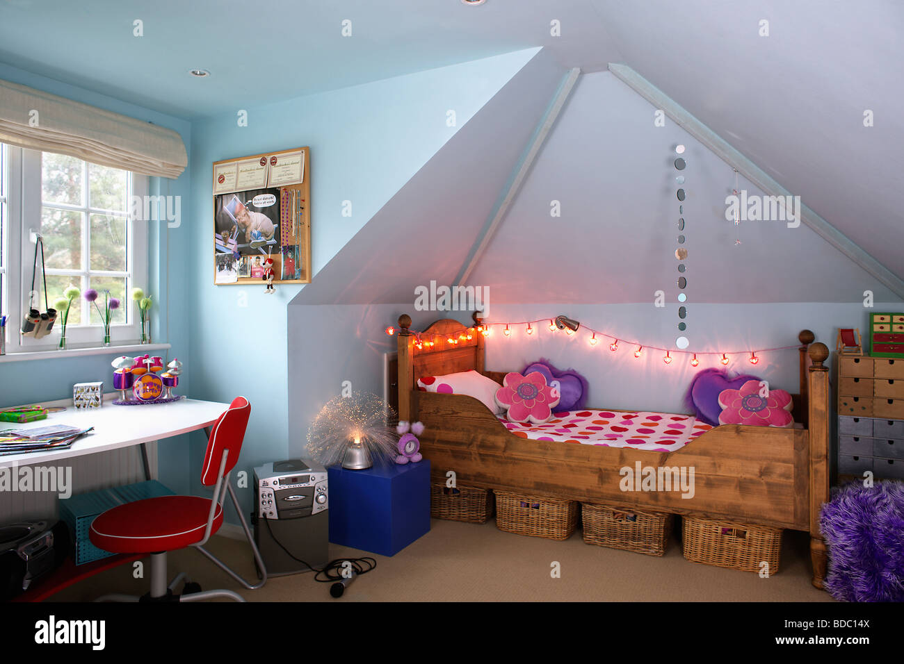 Novelty Fairy Lights Above Wooden Bed In Teenagers Pastel Blue - Fairy lights for teenage bedrooms