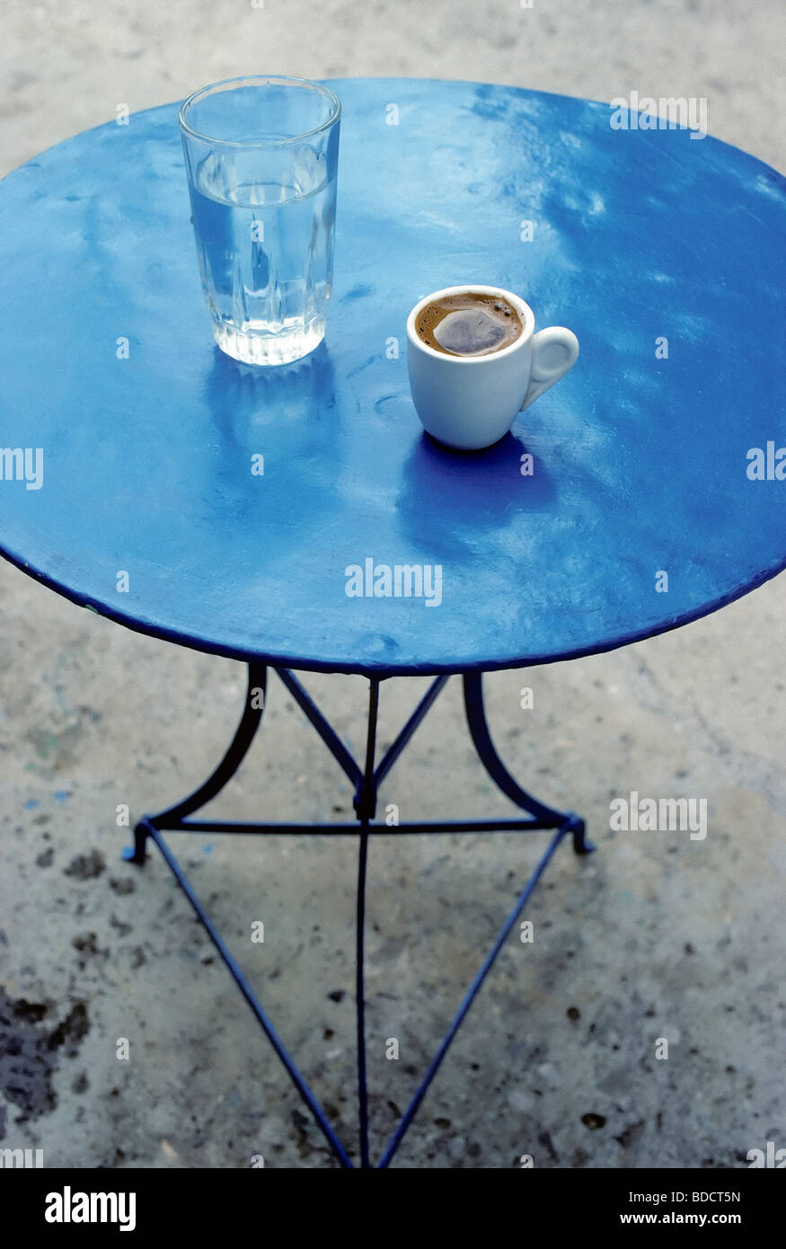Blue iron table with coffee cup and water glass greek coffee blue iron table with coffee cup and water glass greek coffee crete greece europe geotapseo Gallery