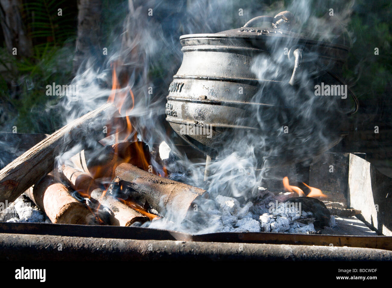 Cooking On An Open Fire With A Cast Iron Pot In South