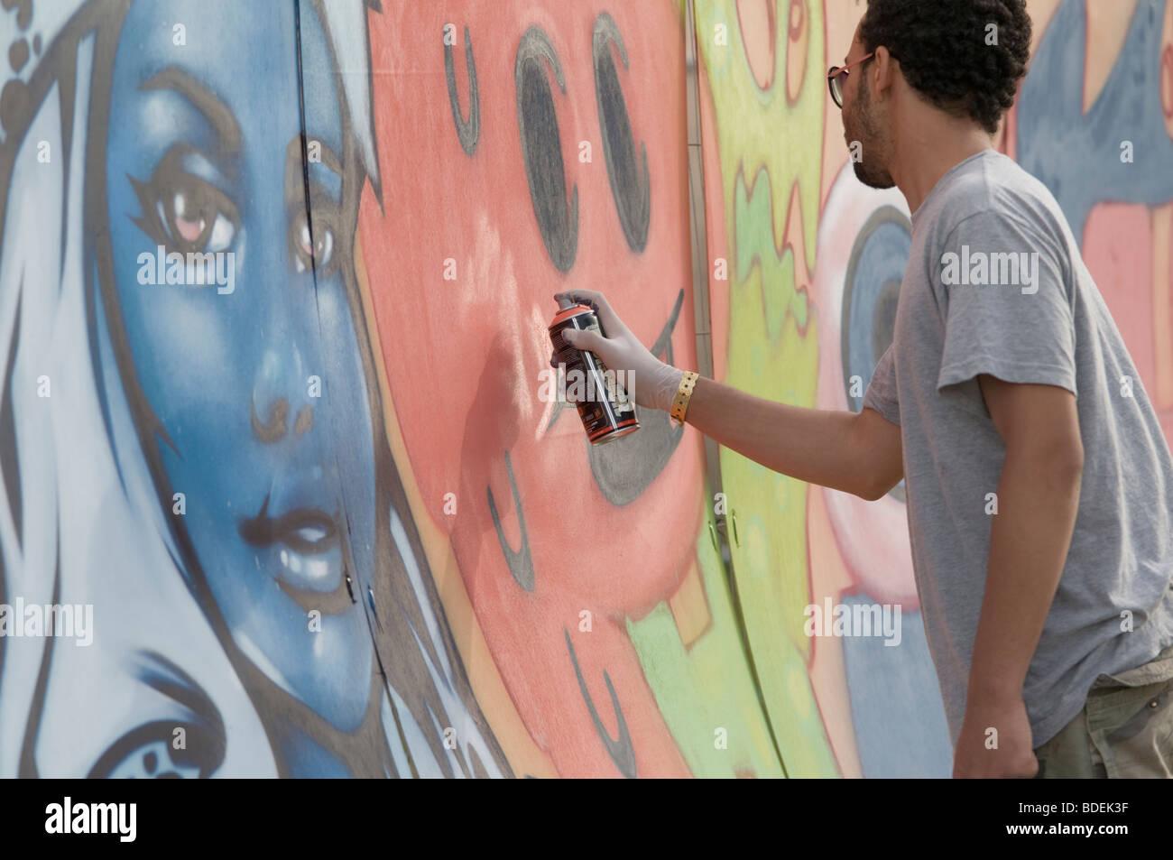 Graffiti wall uk - Stock Photo Young Man Spray Painting A Graffiti Wall At The Square Festival Borth Wales Uk