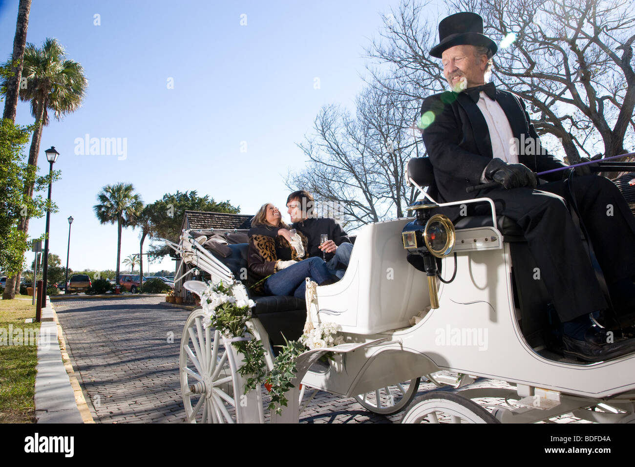 Young couple riding in horse-drawn carriage Stock Photo, Royalty Free Image: 25540490 - Alamy