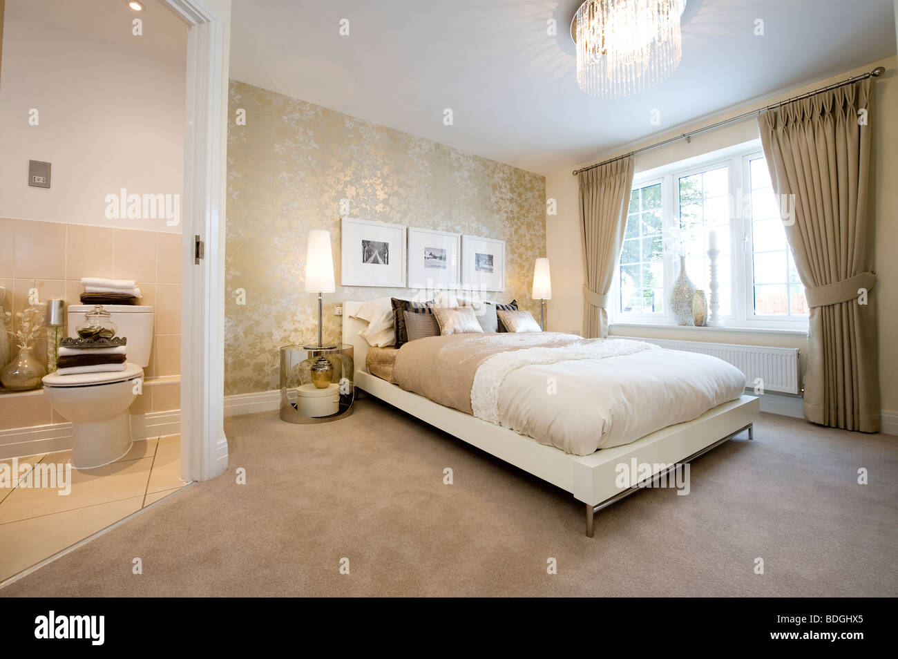 Beautifully decorated bedroom with a double bed and ensuite bathroom in a  show home. Ensuite Bathroom Stock Photos   Ensuite Bathroom Stock Images   Alamy