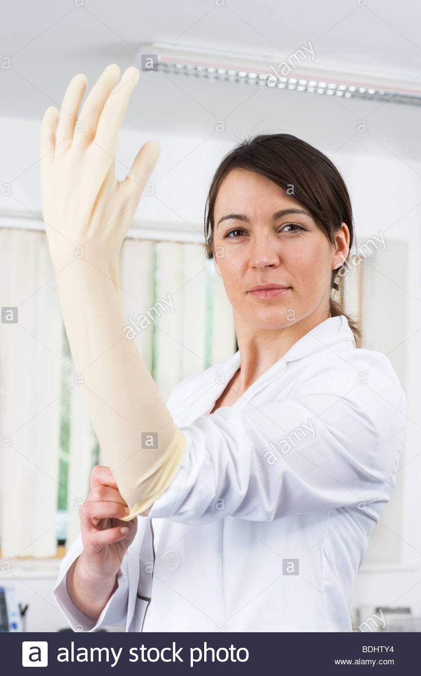 doctor putting on rubber glove with attitude stock photo