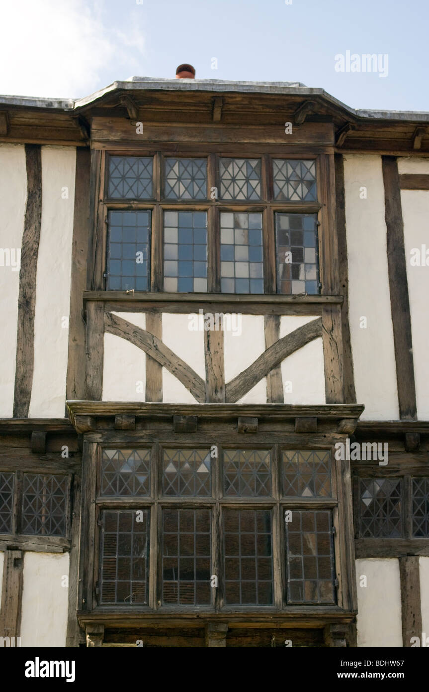 Tudor Facade facade of a tudor building with wooden beams and leaded windows