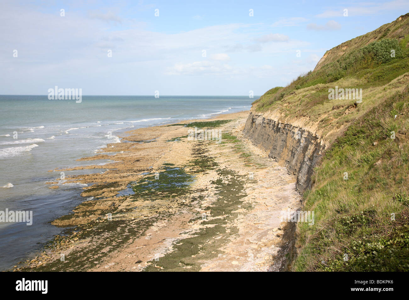Cliffs And Beach At PortenBessin Normandy France Stock Photo - Location port en bessin