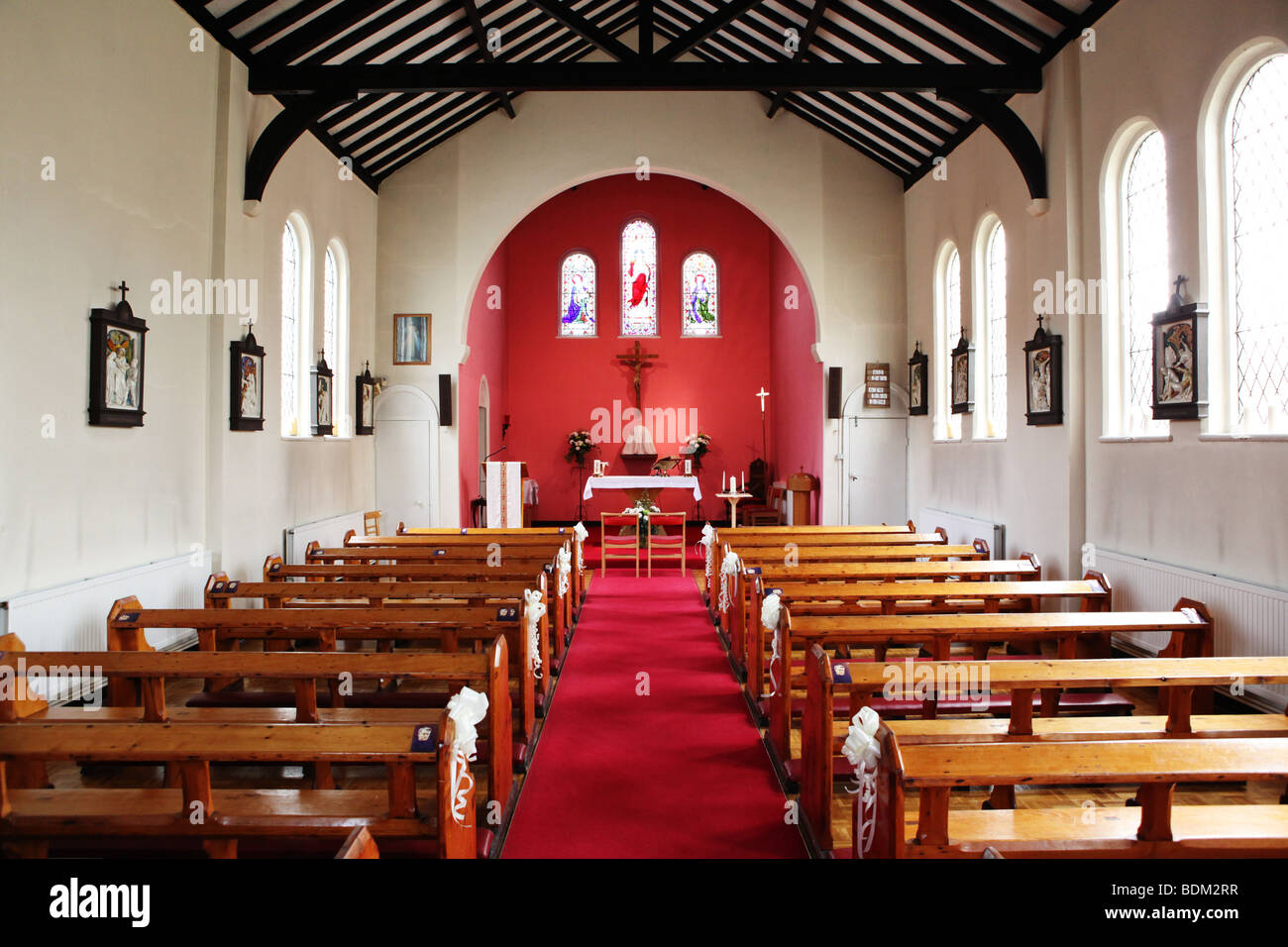 Small colourful empty church with wedding day decorations on ...