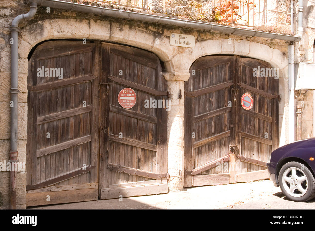 Pair of wooden garage doors in a stone building in the town of puy pair of wooden garage doors in a stone building in the town of puy leveque french no parking signs rubansaba