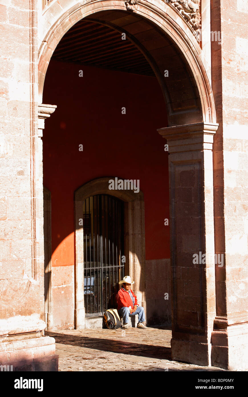 mexican-man-sitting-under-the-portales-o
