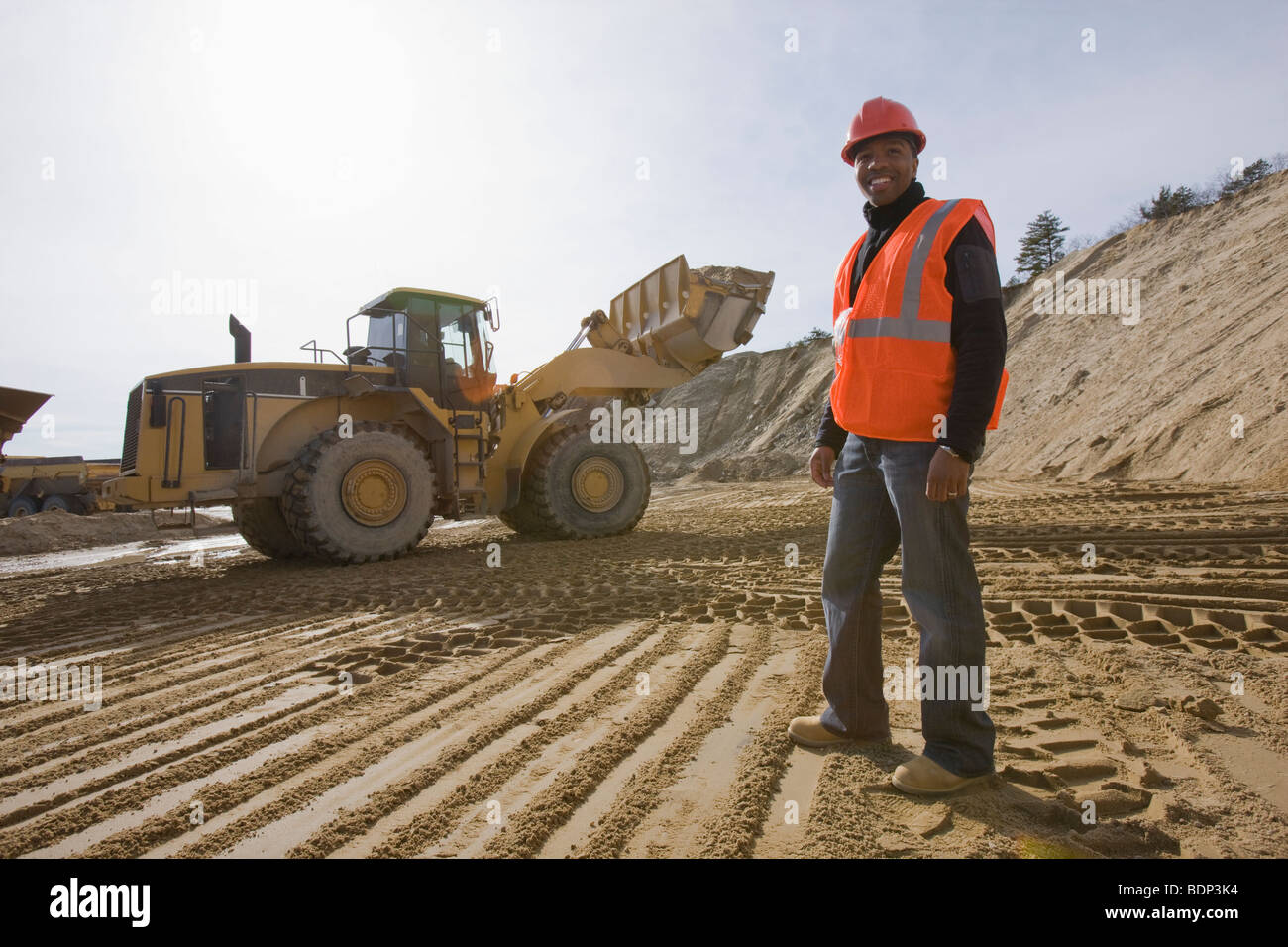 engineer at a construction site with a front end loader in the
