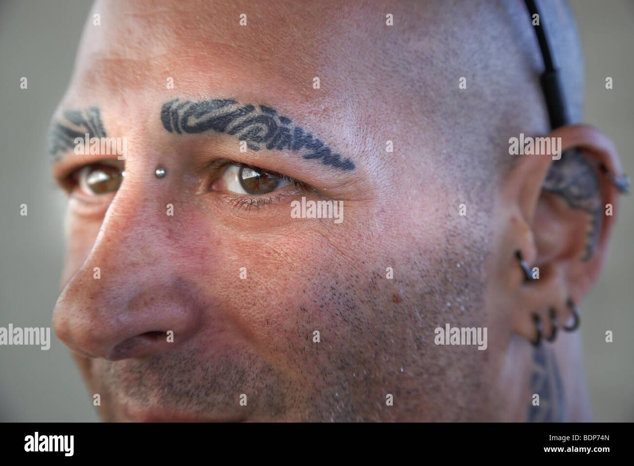 Tattooed eyebrows stock photo royalty free image for Eyebrow tattoo men