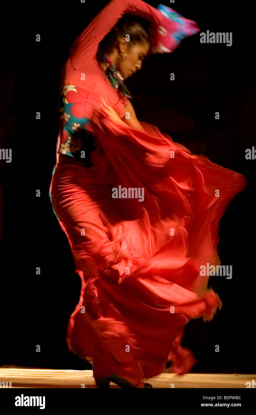 a flamenco dancer in a flowing red dress stock photo royalty free