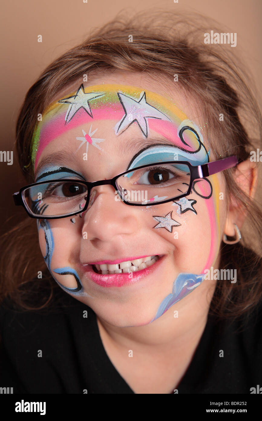 girl with glasses and face paint stock photo royalty free