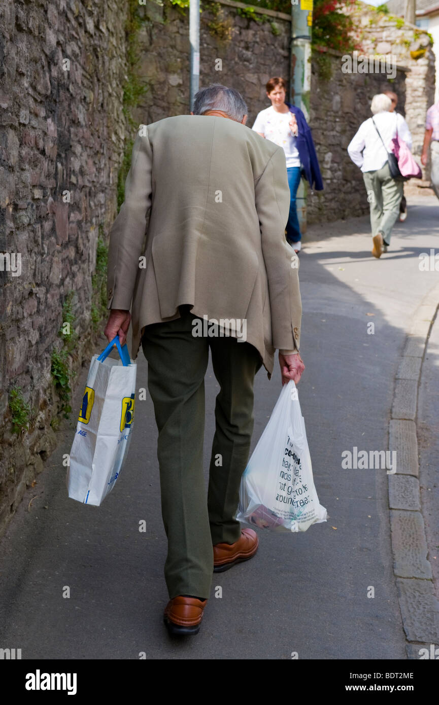 Man carrying shopping bags related keywords