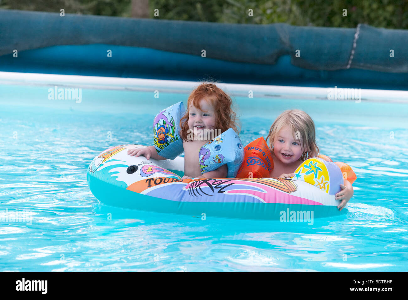 Two Small Girls In Inflatable Boat On Swimming Pool Stock Photo Royalty Free Image 25736858