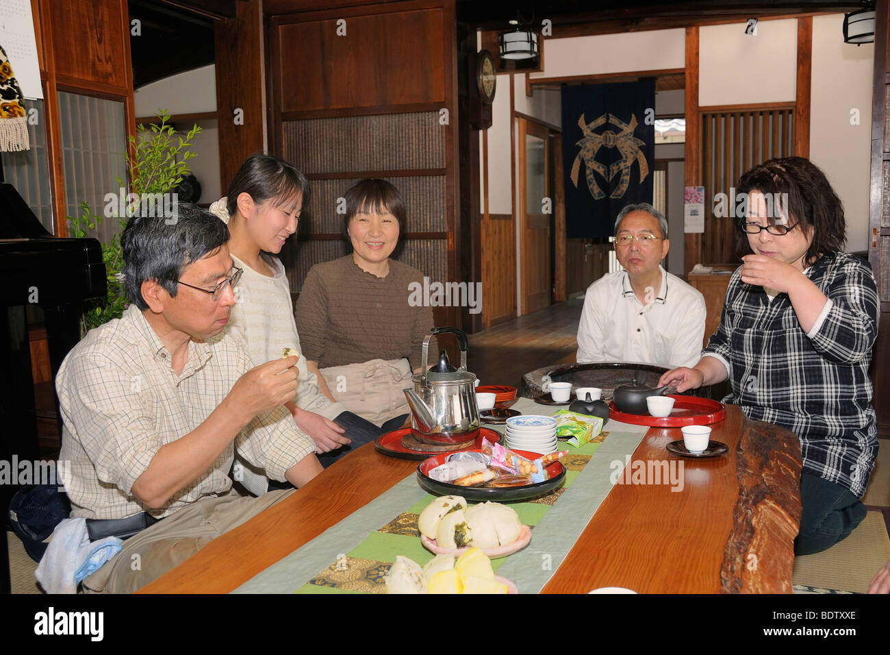 Japanese Family Drinking Tea In A Traditional Living Room In A Stock Photo Royalty Free Image