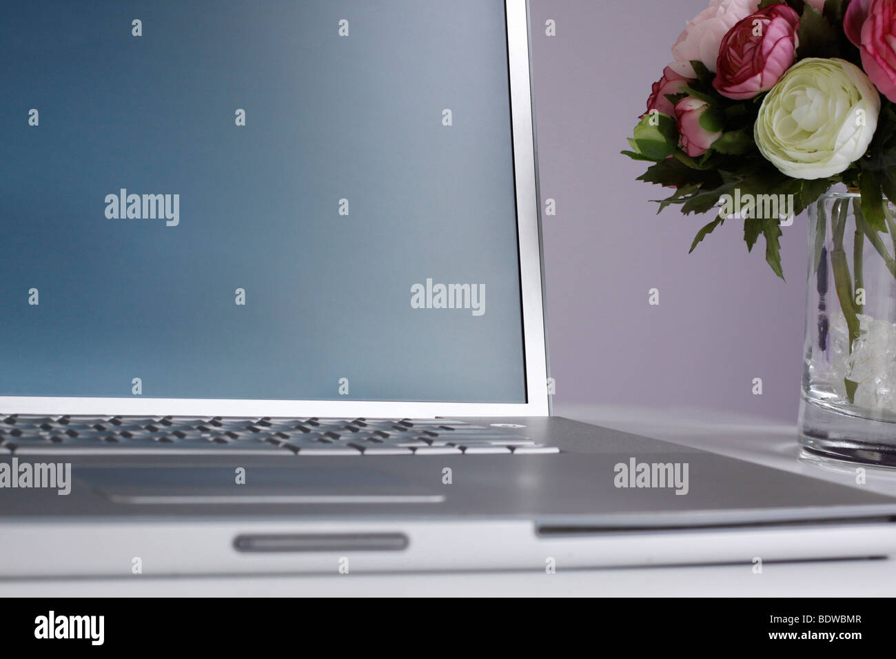 Silver laptop on a desk with a vase with pretty pink and white silver laptop on a desk with a vase with pretty pink and white flowers next to it reviewsmspy