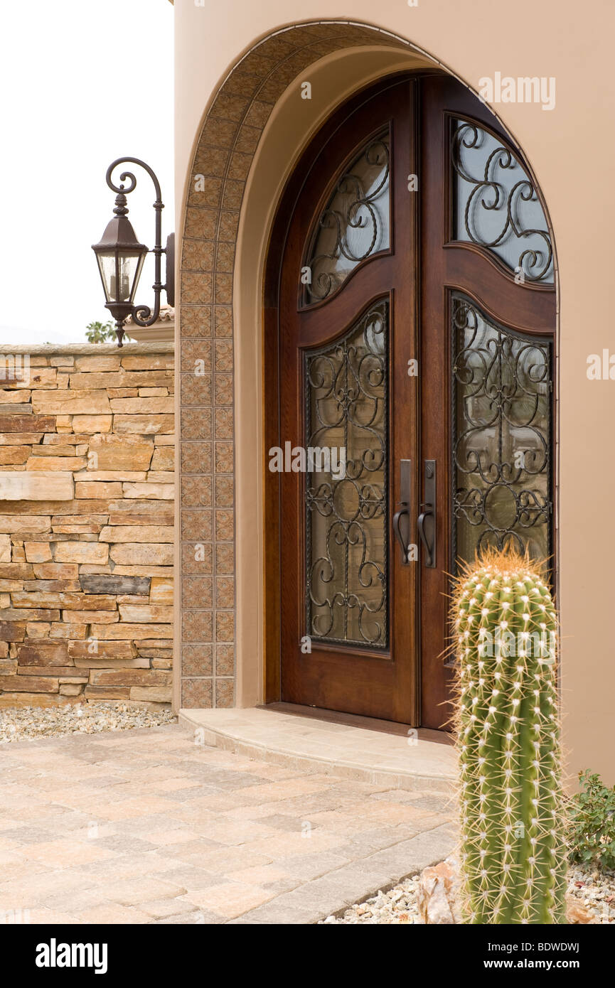 Side view of elegant front door with wrought iron detail for Elegant front doors